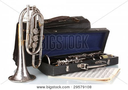 antique trumpet and clarinet in case isolated on white