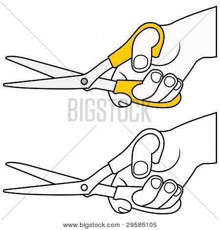 mão com tesoura