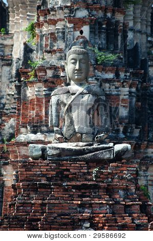 Outdoor stone ancient Buddha in Thailand.