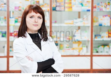 pharmacist chemist woman looking for medicine in pharmacy drugstore with recipe