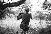 Re-enactor Dressed As Soviet Red Army Soldier Aiming A Sub-machine Gun At Enemy. Wwii Ww2 Russian In poster
