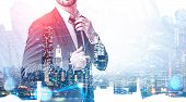 Businessman Fixing His Tie In Night City With Double Exposure Of Network Interface. Concept Of Telec poster