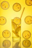 Full Glass Of Fresh Cool Transparent Water With Lemon On Yellow Background poster