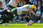 INNSBRUCK, AUSTRIA - JULY 8: WR Ryan Dwyer (#89 Australia) is tackled at the Football World Champion