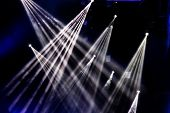 Stage Lights. Several Projectors In The Dark. Multi-colored Light Beams From The Stage Spotlights On poster