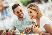 Couple Eating Pizza Snack Outdoors.they Are Sharing Pizza And Eating. poster