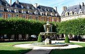 Place Des Vosges, The Oldest Square In Paris. Le Marais District. Paris, France. poster