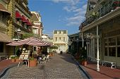 stock photo of yesteryear  - Small Town Shops and Artists on Street - JPG