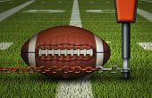 Closeup Of An American Football On The Fifty Yard Line,  Just Inches Away From The First Down Marker poster