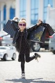 Fashion Trend. Fashion Shop. Little Girl With Bunch Packages. Seasonal Sale. Fashion Girl Customer.  poster