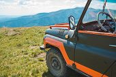Off Road In Mountains. Suv Car Travel Concept. Summer Time poster
