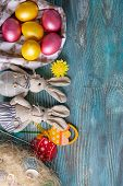 Fluffy Foxy Rabbits With Easter Eggs On Blue Wooden Background poster