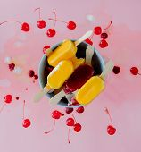 Lemon Ice Lollys With Raspberries And Cherry On Pink Background. poster