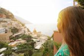 Happy Young Woman Looking At Positano Village. Rear View Of Girl Enjoying Positano Townscape, Amalfi poster