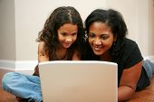 image of mother child  - Young girl with mother on the computer - JPG
