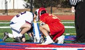 Two High School Boys Are Ready For The Faceoff During A Lacrosse Game On A Colorful Turf Field. poster
