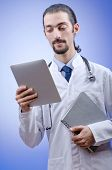 pic of male nurses  - Doctor working on the tablet - JPG