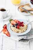 Breakfast Oatmeal Porridge With Fruits Berries And Coffee Cup. Oatmeal With Strawberries And Berry.  poster