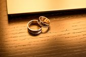 Pair Of White Gold Wedding Rings With Diamonds In Womens Ring And Matte Surface In Mens Ring. Silver poster