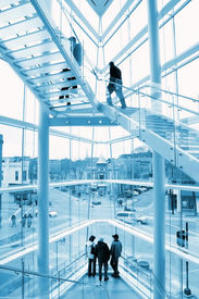 pic of commercial building  - Interior of a modern glass building looking out on a historic street - JPG