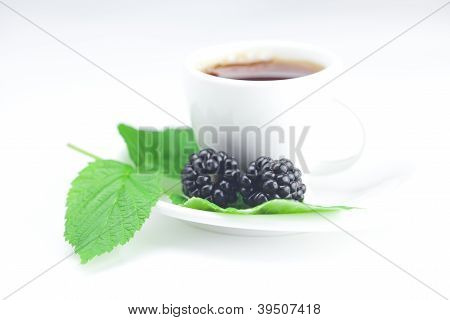 Cup Of Tea And  Blackberry With Leaves