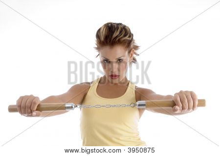 Woman With Nunchaku
