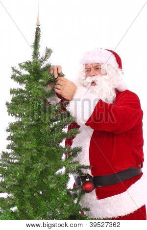 Santa decorating a tree