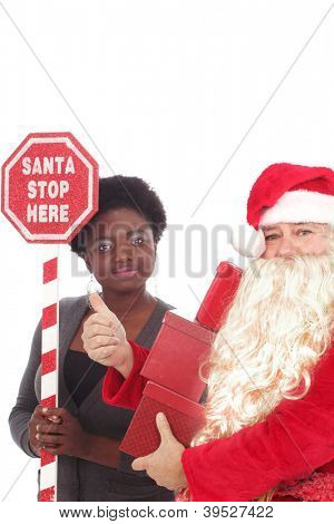 Santa with a young woman holding a sign