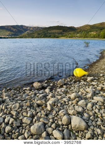 Yellow Buoy In The Lake Sant Antoni
