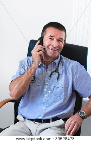 Doctor Talking On Mobile Phone