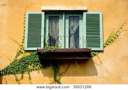 Vintage windows on the yellow wall