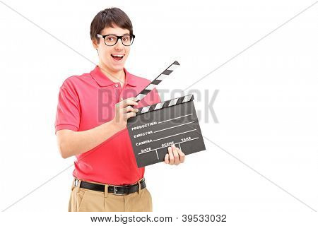 A smiling man with glasses holding a movie clap isolated on white background