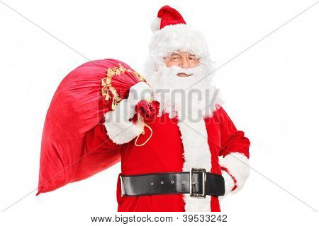 A Santa Claus posing with a bag full of gifts on his back isolated on white background