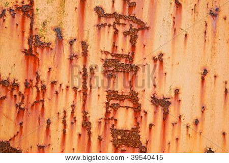 part of old weathered metal with orange paint