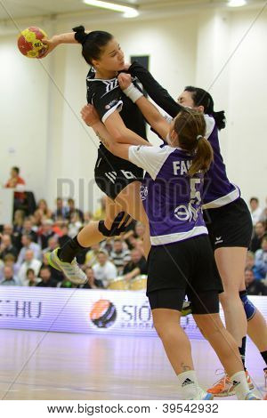 SIOFOK, HUNGARY - NOVEMBER 17: Nikolett Varga (L) in action at EHF Cup handball match Siofok (HUN) vs. Astrakhanochka (RUS) November 17, 2012 in Siofok, Hungary.