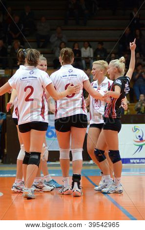 KAPOSVAR, HUNGARY - OCTOBER 14: Kaposvar players celebrate at the Hungarian I. League volleyball game Kaposvar (white) vs Nyiregyhaza (black), October 14, 2012 in Kaposvar, Hungary.