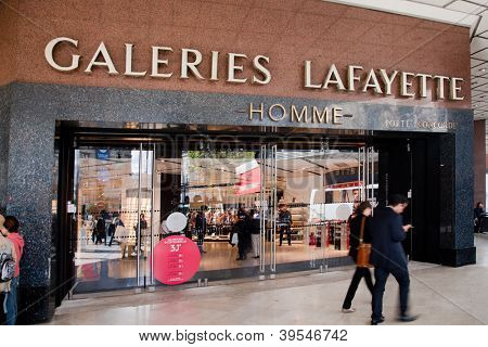 PARIS - OCT 2: Shoppers walk past the entrance to Lafayette shopping center on October 2, 2012 in Paris. The Galeries Lafayette has been selling luxury goods since 1895.
