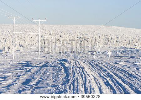 Skiing Tracks Going Downhill