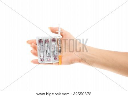 Diabetes Concept. Hand With Syringe Injector And Insulin Vials