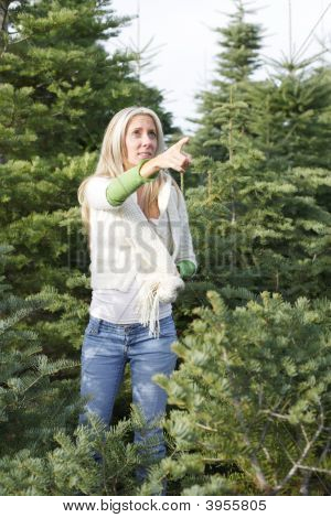 A Woman Wondering Threw Christmas Tree Lot