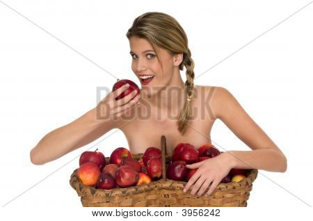 Young Blond Woman Taking A Bite Of Red Apple