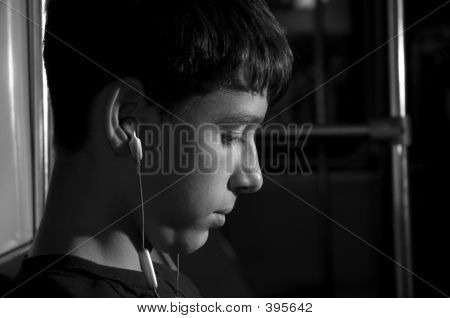 Teenager With Ear-phones