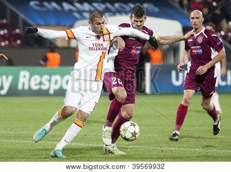 CLUJ-NAPOCA, ROMANIA - NOVEMBER 7: Burak Yilmaz and Cadu  in UEFA Champions League match between CFR 1907 Cluj vs Galatasaray, on 7 Nov., 2012 in Cluj-Napoca, Romania
