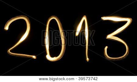number 2013, as the new year, written with light beam on a black background