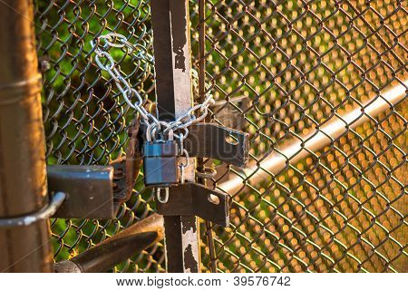 Padlock On Wire Fence