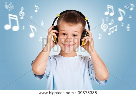 attracive kid is listening music with headphones