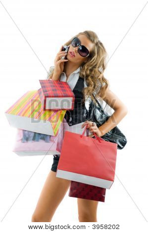 Close Up Of Happy Young Woman On A Shopping Spree. Talking By Phone