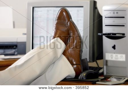 Feet On A Desk