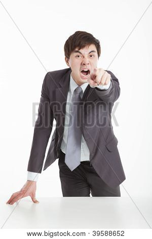 Angry Businessman Pointing You
