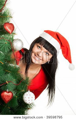 Woman in red cap looking out of Christmas tree